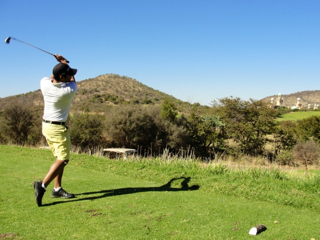 Dwain Margro teeing it up on the par 3 8th hole at Lost City Golf Course