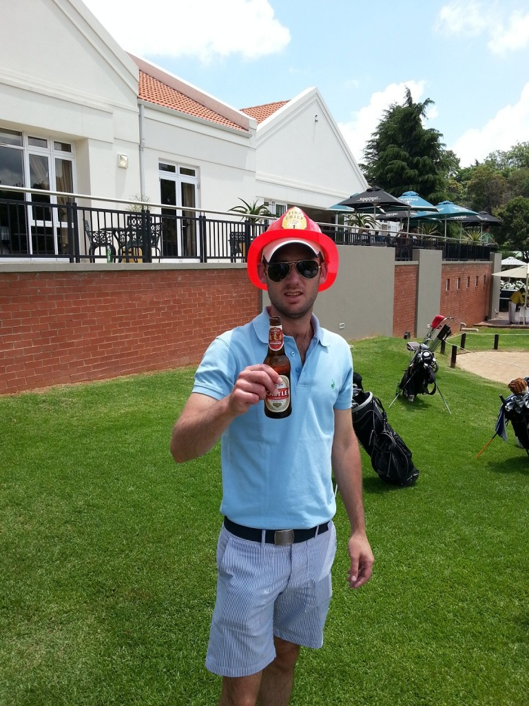 Chad Campbell sporting the fireman's helmet (and a beer)